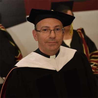 REV. DR. MITRI RAHEB
